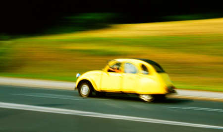 Yellow car in motion Stock Photo - 300385