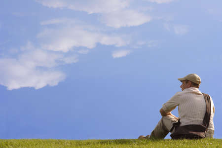 A man sitting on the grass photo