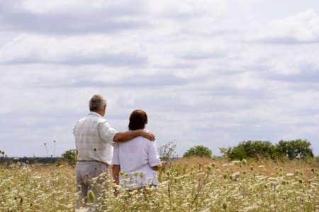 old man walking: A senior couple enjoying their life Stock Photo