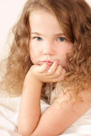 Little girl looking pensively photo