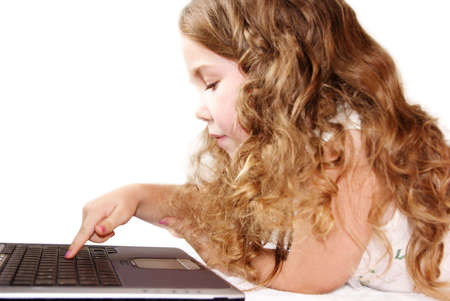 Little girl with finger on computer keyboard photo