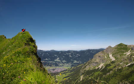 coutryside: Hiker in the mountains , Allgäu Alps, Oberstdorf, Bavaria, Germany