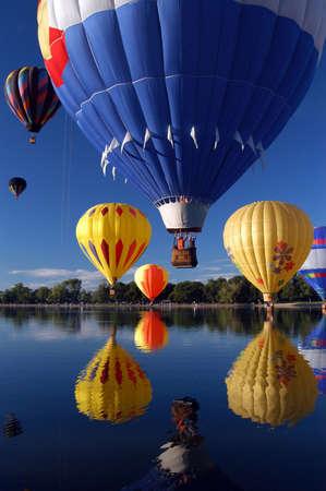 Hot Air Balloon ride over lake Banco de Imagens