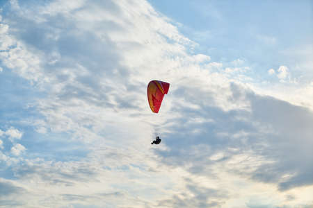 Paragliding in the blue sky Stock Photo