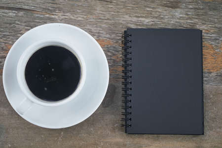 Black notebook and black coffee