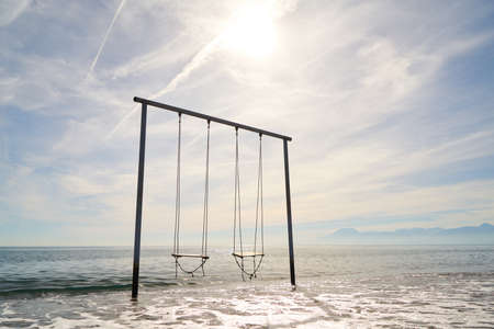 A swing in the middle of the sea