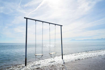 a swing in the middle of the sea Zdjęcie Seryjne