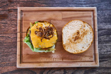 Delicious cheeseburger on the wooden table Stock Photo