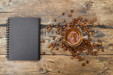 Coffee, coffee beans and notebook