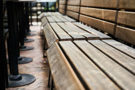 Wooden benches of a cafe Stok Fotoğraf