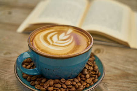 Latte coffee, coffee beans and book