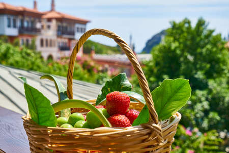 Strawberries and plums in the basket