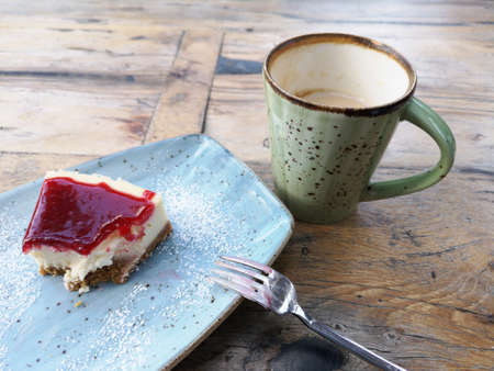 cheesecake and coffee cup on the table