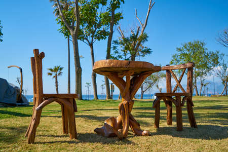 wooden table and chair on grass