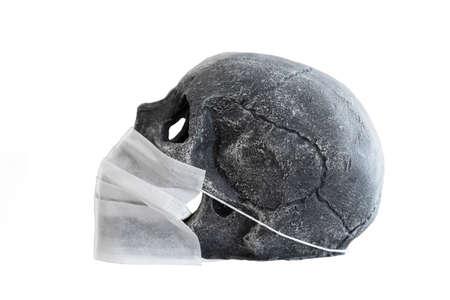 Concept shoot with skull and coronavirus mask Imagens
