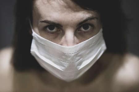 coronavirus mask and woman portrait