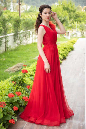 a young girl in red dress
