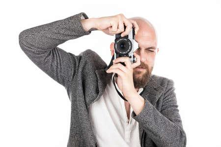 a male photographer and his retro camera