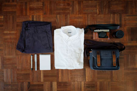 paquet: White Shirt, Lecture note, Bag and Camera ready for going out Stock Photo
