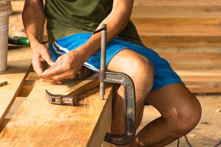 stillife: Carpenter working with equipment in his hand  plan.Zoom in  and stillife. Stock Photo
