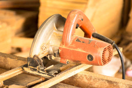electric saw: Electric saw with sawdust background in workplace of carpentry.