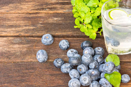 detoxification: Drink Detoxification,blueberry and lemonade water.Fruit and health.Close up. Stock Photo