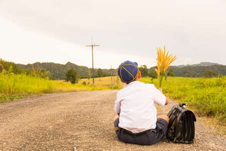 livelihoods: Asian student sitting  and country view.Or Livelihoods of rural children1