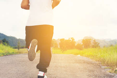 Man running   and nature background view.Back of a man Stock Photo