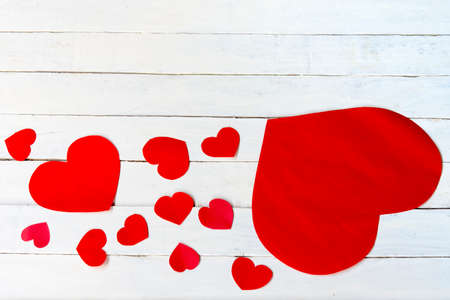 Heart valentine and white wooden background.Top view.