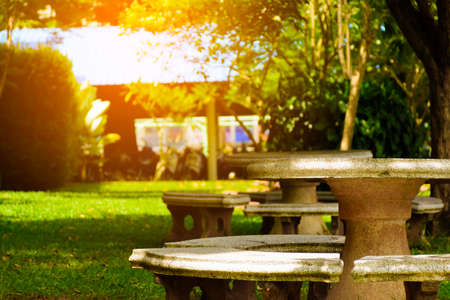 Stone Bench Set In The Garden With Sunshine Stock Photo Picture - Stone picnic table set