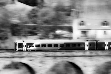 Speeding train on railway photo