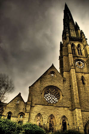 Old derelict church and clock tower photo