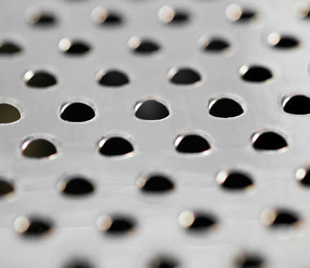 cheese grater: Macro of cheese grater Stock Photo