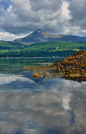 Reflections in the water on the Isle of Arran, Scotland photo