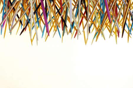anodized: knitting needle backgrounds