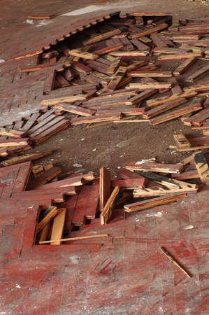 splintered: wooden parquet floor red crumbled Stock Photo