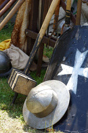 a cudgel: helmet shield and Cudgel historical weapons Stock Photo