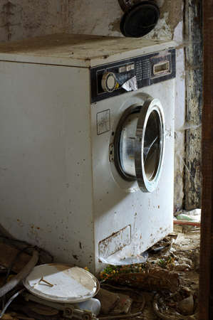 abandoned: broken washing machine