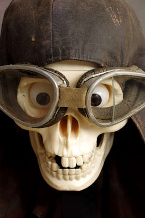 old motorcycle: old motorcycle goggles and helmet the skull