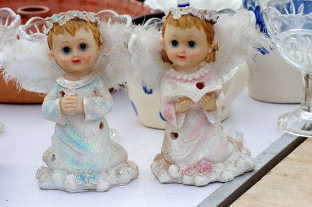 statuettes: boy and girl cherub Statuettes flea market