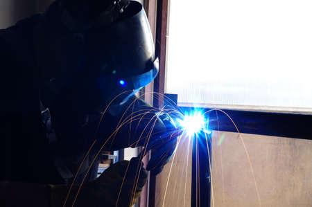 Welder welding pipes work
