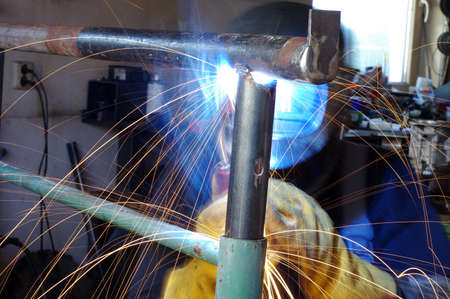 Welder welding pipes Reklamní fotografie