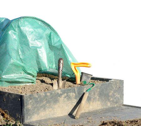 spade raised garden bed and polytunnels gardening tools Reklamní fotografie