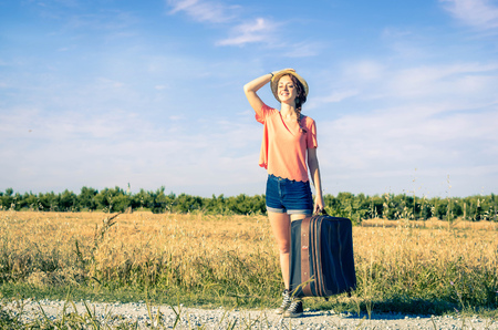 successful campaign: girl laughs happily on her vacation - holidays, people and lifestyle concept