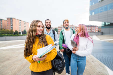 Multiracial students walking on city street - New normal lifestyle concept with friends wearing face mask going at school