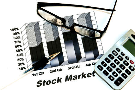black stock market chart with glasses,pen and calculator Stock Photo