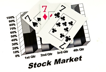 quarterly: black stock market chart with playing cards,sevens Stock Photo