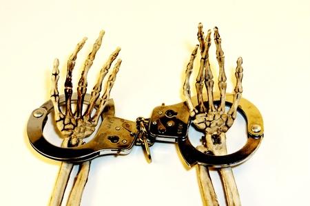 Skeleton hands in handcuffs