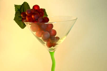 Grapes in a wine glass with green stem Stock Photo