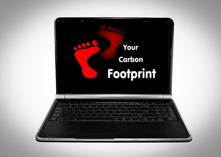 Opened laptop computer with carbon footprint in red
